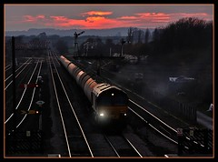 Day's End at Barnetby (SydPix) Tags: sunset red orange station backlight evening diesel shed trains signals locomotive railways freight tanks tankers signalbox class66 ews semaphores barnetby 66120 sydyoung
