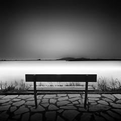 the vision (Julia-Anna Gospodarou) Tags: longexposure sunset sea blackandwhite bw white seascape bench nikon moody patterns smooth greece vision le tamron contrasts symbolic 2012 manfrotto hoya darksky nd400 messolonghi manfrotto055xprob nikond7000 juliaannagospodarou siruik20x tamronaf18270mm3563pzd