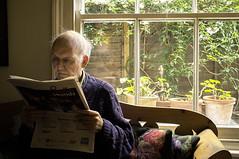saturday paper (lesbru) Tags: portrait window kitchen newspaper lowlight jonathan interior grainy highiso x100