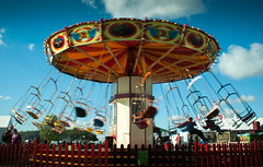 Fair fun. (David M:) Tags: street uk trip travel carnival blue light red summer vacation england sky people music sunlight holiday motion blur color colour green art english beautiful beauty sunshine clouds composition contrast rural vintage landscape fun countryside photo movement nikon europe raw shot image britain weekend candid country north norfolk roundabout scenic picture style fair scene structure swing retro steam sharp nostalgia photograph shade saturation british form shape favourite tone icm available tonal lightroom compose pensthorpe d5000