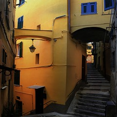 A labyrinth of carruggi's leading to the upper town of Vernazza (Bn) Tags: santa travel blue sea summer cactus italy sun holiday castle art heritage beach church water colors fruit swimming painting boats harbor fishing sand alley topf50 colorful mediterranean kayak village hiking walk liguria steps tourist lovers unesco trail vineyards kayaking olives cinqueterre charming opuntia vernazza viewpoint picturesque topf100 sunbathing margherita sunbather italianriviera ruined alleys nocars pamtree rockycoastline viadellamore 100faves 50faves carruggi 32c dantiochia
