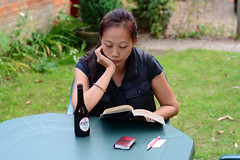 Cider and a Book (Bob Hawley) Tags: nikond7100 summerholidays england suffolk theberton nikon50mmf14 holidaycottages people women reading cider outdoors
