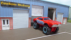 A New Conversion from Custom Motors. (ManOfYorkshire) Tags: hotwheels diecast 164 scale model toy 442 1969 custom customised custommotors diorama raised painted altered modified bigfoot special daredevils range 2016 show stopper extended suspension wheels large oldsmobile garage shop unit industrial