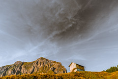 A House in The Mountains. (marco soraperra) Tags: house hat landscape cliff mountain grass sky clouds light shadow sun sunset sunlight nikon nikkor september