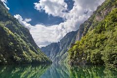Tree Covered Mountain (Irene Becker) Tags: sky reflection green river serbia balkan srbija reka republikasrpska taramountain zapadnasrbija irenebecker irenebeckerorg taranationalpark imagesofserbia drinacanyon serbianlandscapes