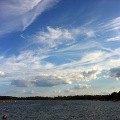 summer clouds [Sweden 2011] (SS) Tags: blue light sea summer vacation sky white seascape green nature water colors weather clouds composition contrast forest skyscape landscape photography paint day waves mood dof view wind sweden pov 4 year perspective scenic july gimp cielo vista sverige tones bianco depth comments foreshore vastness celeste iphone svezia atmophere immensit