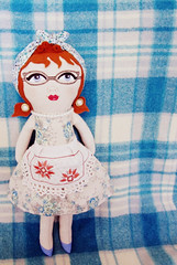 Handpainted Hilda Doll 2 (A Little Vintage) Tags: doll dolly doily dress different face flower fabric handpainteddoll handpainted handmadedoll handpainteddolls hair retro ragdoll red repurposed redhead glasses catseyeglasses 50s fifties mid century housewife apron earrings kitch softie softtoy softies blue blueeyes