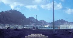 "From the Causeway approaching the ""Maala Striaght"", Aden, Yemen (Ivor ""Taff"" Davies) Tags: landscape volcano middleeast 1966 1967 yemen 1960s volcanic 1965 aden scannedslide gulfofaden arabianpeninsula southyemen adenharbour voigtländervitoc jebelshamsan"