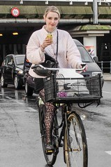 Bad weather in Amsterdam (105mm) Tags: street city people woman stockings girl smile rain amsterdam weather fashion bike bicycle happy outfit women pretty phone candid style skirt bicycles pantyhose telefoon fiets streetwear mensen streetfashion streetstyle