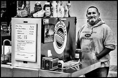One of the Hot Dog Guys (alhawley) Tags: american bw k01 smcpentaxda21mmf32limited usa blackandwhite everytownusa justpentax monochrome pentaxk01 pentaxlife pentaxlimited photoessay photojournalism street streetphotography