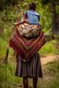 Mom and son with Noken (tehhanlin) Tags: indonesia papua westpapua irianjaya nusantara honai noken wamena sony a7r2 a7rm2 ngc travel portrait humaninterest sukudani jayapura koteka