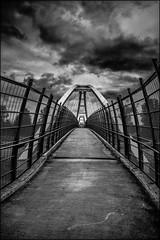 Pedestrian Overpass (Martin Smith - Having the Time of my Life) Tags: pedestrianoverpass overpass surrey tyneheadpark hwy1 nikkor2485mmf3545gedvr nikond750 silverefex bw monochrome vanishingpoint dramaticclouds britishcolumbia canada ca