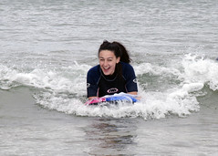 on her way to shore (Lisangel) Tags: bendhu holiday summer ulster nikon d7000 beach strand portstewart sea surf surfing boogieboard board