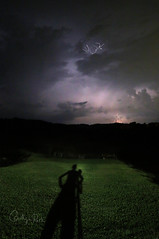 An Energy That Only Comes from Watching, Really Watching, Lightning Strike and Turn the Clouds Brilliant Colors (Caitlyn Park) Tags: lightning storm thunder august shadow self clouds thunderstorm summer tripod night sky