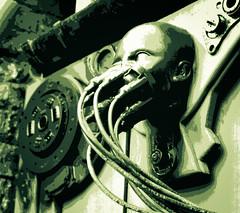 cyber gargoyle split-toned 01 oct  99 (Shaun the grime lover) Tags: cyberpunk cyber gargoyle cyberdog camden london splittoned posterised posterized monochrome sculpture stables market