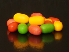 Macro Mondays - Sweet Spot Squared (Explored 19th September 2016) (sylviamay1963) Tags: macromondayssweetspotsquared sweet spot f32 sonya58 tamron90mmmacro tictacs reflection orange red green yellow sweets candies lollies bonbons black