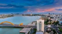 Panoramic Da Nang (free3yourmind) Tags: panoramic panorama danang vietnam city cityscape clouds cloudy river dragon bridge sunset