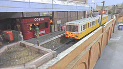 Tyneside Metro Unit Arrives at Penna Lane Station. (ManOfYorkshire) Tags: penna lane tmd station railway train tyneside metro 4001 arrival 176 scale model oogauge kit built costa booksellers airfix coffee dcc operation smooth runner yellow electric electrified arches pantograph 122