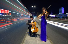 Cellist & Violinist Performing in Traffic (Anatoleya) Tags: bridge light people musician 3 london musicians night canon prime evening long exposure traffic mark f14 iii trails waterloo violin cello l 5d 24mm violinist cellist 5d3 anatoleya