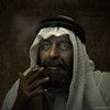 (.Ian Mylam.) Tags: street portrait man bahrain gulf cigarette smoke smoking arab arabia keffiyeh igal egal dishdasha thawb agal babul arabianpeninsula thobe kandura iqal suriyah