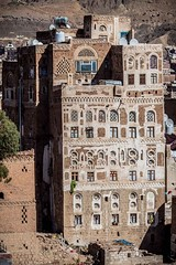 old palaces with the yemenistyle in the old Sana'a, yemen (anthony pappone photography) Tags: world pictures travel windows architecture digital canon lens photography photo republic foto image picture culture palace best unesco arab arabia yemen fotografia sanaa ramadan reportage photograher sejima suk finestre arabo yemeni phototravel yaman arabie arabiafelix arabieheureuse  arabianpeninsula        alyaman yemenpicture yemenpictures ornatewindows eos5dmarkii   carvedwindows  mediorient