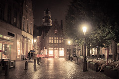 Lovers in the Rain (Gilderic Photography) Tags: street city trip travel windows urban woman house cinema man tree church wet rain architecture night umbrella canon eos lights couple europe raw cityscape cathedral belgium belgique belgie widescreen low brugge wide large pluie surreal lovers lumiere romantic bruges lamps cinematic maison rue nuit ville fenetre cathedrale parapluie lightroom pav 500d romantique humide saintsauveur gilderic