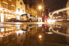golden turn (maybemaq) Tags: road street city uk longexposure england sky urban reflection bus london cars car rain bike night turn puddle gold mirror golden evening strada rainyday traffic camino britain geometry camden bikes ground double symmetry beam lighttrails curve reflexions aftertherain camdentown recent hummus doubledecker caminho wineshop waterreflection lowangle camdenroad lightstream wetreflection maybemaq colorphotoaward
