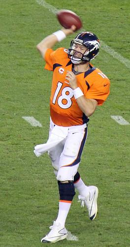 Peyton Manning throwing  a pass -- intensively.