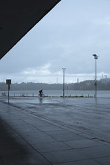 Cyclist in rain (Mikko Miettinen) Tags: autumn lines rain bike bicycle fog architecture suomi finland helsinki cyclist perspective rainy syksy finlandiahouse