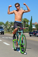 Young Bravado (Chris Hunkeler) Tags: shirtless two man men boys bicycle cycling colorful arms young riding pch teenager guns fit teenage nohands lean flexing pacificcoasthighway jungenbekleidung