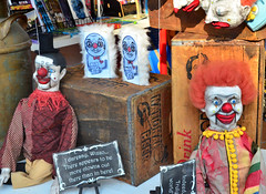 Clowns on Display in a Store Window
