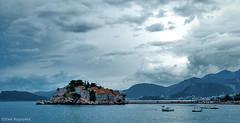 View of Sveti Stefan (Ewa Rogoyska) Tags: blue sea sky mountains clouds landscape boats island hotel resort stefan balkans islet gora montenegro budva sveti crna