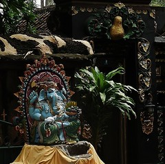 Ganesha, the Elephant God (SM Tham) Tags: asia indonesia bali island candidasa statue ganesha elephantgod mouse pedestal entrance doorway wall plant outdoors fruits fruitbowl