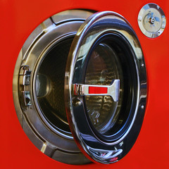 Experiment with reflections in the laundromat (juliensart) Tags: red reflection metal canon photography fotografie experiment machine ixus laundry rood washing launderette wasmachine wasserette juliensart 115hs