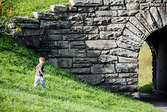 Commence Exploration (-bdm-) Tags: boy fall grass rocks arch son tunnel explore doorway trail archway d80 mosescone