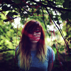 Bound into Nature (rebeccapalmer.) Tags: trees red selfportrait wool nature ties trapped woods bokeh string tied binding rebeccapalmer