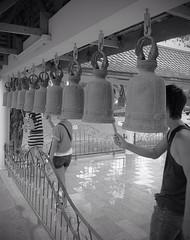 Ringing The bells (Stuart Lilley Photography) Tags: blackandwhite bw bells thailand temple blackwhite fuji pattaya hs30