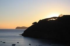 Pareti Beach (Teo Senbei) Tags: sunset sea summer italy beach canon island eos bay elba italia tramonto mare estate august cliffs agosto spiaggia 2012 isola scogliere baia pareti capoliveri 450d