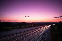 (drfugo) Tags: road bridge sunset sky cloud tree lamp field night fence traffic post motorway surrey bluehour m25 lightstreaks sigma28mmf18exdg canon5dmkii whitehilllane thoughikindoflikeit cheapobigstoppermakespurples