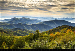 Blue Ridge Parkway Sunrise - Light, Lines, and Leaves (Dave Allen Photography) Tags: morning blue autumn orange mountains fall nature yellow sunrise nc asheville north scenic northcarolina foliage ridge parkway carolina peaks oaks maples appalachia blueridgeparkway ridges appalachians wnc westernnorthcarolina greenknob mygearandme mygearandmepremium mygearandmebronze mygearandmesilver mygearandmegold mygearandmeplatinum mygearandmediamond