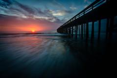Amelia Island Sunrise (Jeremy Duguid) Tags: travel sun beach sunrise canon island dawn pier sand long exposure day waves florida cloudy jeremy fl amelia fla 1000 fernandina duguid pwlandscape jeremyduguid