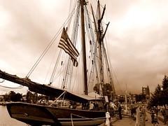 The age of sail returns to Marquette (yooperann) Tags: pride baltimore tall ship sailing boat rigging flag sepia oldfashioned marquette upper peninsula michigan