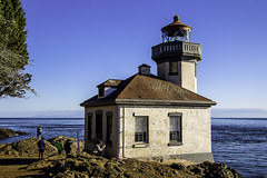 Lime Kiln Point Lighthouse (woodchuckiam) Tags: limekilnpointlighthouse limekilnpointstatepark sanjuanisland washington lighthouse tower ocean waves sky trees rocks shore point rockypoint navigationalbeacon harostrait