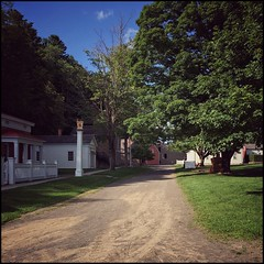 Dusty Street -66/100 (Firery Broome) Tags: street dirt dusty green trees drugstore history historic village farmersmuseum cooperstown newyork historicplaces travel worldtravel architecture cellphone phonephoto iphone iphone5s ipad ipaddarkroom apps snapseed square streetscene landscape squarelandscape squarearchitecture 100xthe2016edition 100x2016 image66100 ny nyhistory 365