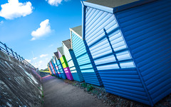 The Summer Dimension (DobingDesign) Tags: seaside beachhuts beach seafront perspective shadow blue vanishingpoint panels wood colours bluesky huts whitstable kent lines stripes coast english summer summertime sunshine sunlight architecture architecturaldetail retro colourful multicolour