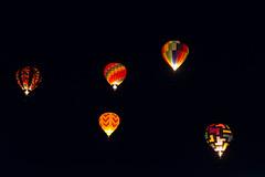 Balloons (Disorderly) Tags: travel night dark flying colorful darkness nevada hotair transport balloon floating transportation hotairballoon glowing lit reno soaring alight