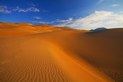 The Great Sand Dunes (Matt Champlin) Tags: life morning vacation holiday nature sunrise canon giant walking landscape landscapes amazing colorado peace hiking dunes calming peaceful roadtrip calm hills idyllic tranquil rolling greatsanddunes sanddunes 2012 greatsanddunesnationalpark curving dunefield