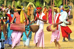 Poush Mela @ Santiniketan [Explored] (pallab seth) Tags: woman india man festival religious dance nikon folk religion culture dancer tribal hindu bengal cultural shantiniketan westbengal 2011 adivasi tusu groupdance santiniketan bolpur makarasankranti poushmela parab d3100  grambanglarchobi