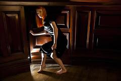Secret Door (Miss Tanith) Tags: door wood girls orange girl contrast dark hair newcastle walking person ginger high doors dress panel secret flash tyne creepy lass step stepping surprised about erika through toon caught geordie upon tanith lasses pannelling erikatanith