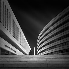 converging (Julia-Anna Gospodarou) Tags: city sky urban blackandwhite bw building monochrome lines architecture modern clouds stairs dark square nikon tripod curves steps perspective dramatic athens highlights symmetry greece direction le round balance tall polarizer tamron contrasts 2012 manfrotto modernbuilding hoya curtainwall rectilinear glasswall converging blacksky nd400 assymetry manfrotto055xprob nationalinsurancecompany bw106 nikond7000 tamronaf18270mm juliaannagospodarou siruik20x 3563pzd